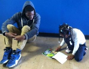 Kyare and his student, reading.